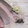 The head stops of the east window depict butterflies, though the erosion of the soft local sandstone makes this difficult to see.
