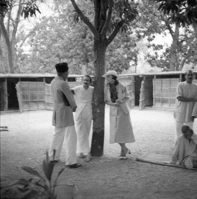 MSI Collection ; possibly Rahuri, India - Meher Baba & Norina Matchabelli talking to Ramjoo.Baidul in background