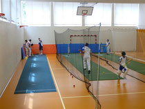 Using the bowling machines at indoor net sessions for one to one coaching