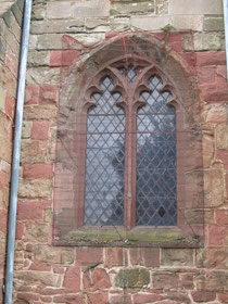 The 15th-century west window in the tower. Note the rubble wall below the window.
