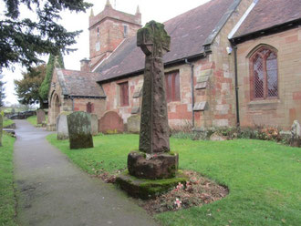 The base of this cross on the south side of the church dates from the Saxon period and is probably older than the church itself