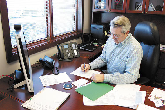 Dave North, President and CEO of Sedgwick Claims Management Services, works in his Bellevue office