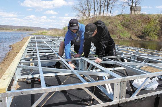 Justin Harms and Mike Valant worked to assembled the new 16 x 40-foot practice dock that arrived here from a company called Tiger Docks in St. Louis, Missouri last week. The dock, which was custom-designed to hold 30 skiers at once on the take-off side, w
