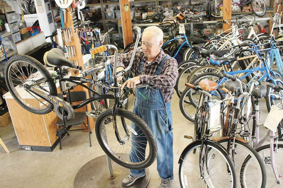 "Mark Rogge, owner and lead mechanic at Bellevue's Backwaters Bicycle Shop, works on one of his many Sun bicyles at his shop on South Second Street. The brand has been heralded for its unique and comforable ""foot forward"" design."