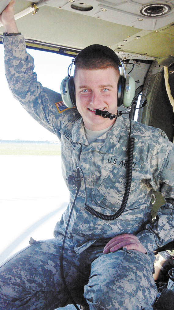 Iowa National Guardsman Steve Moellers of Bellevue is pictured here inside a Black Hawk helicopter in Kosovo. (photo courtesy Moeller family)
