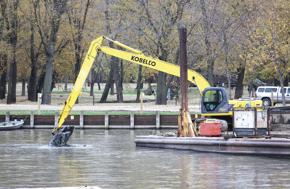 Crews from Newt Marine of Dubuque were busy at Spruce Creek Harbor last week removing 3,000 cubic yards of material from the water bottom. The $90,000 dredging project will create a better habitat for fish during the winter and provide a better flow in th