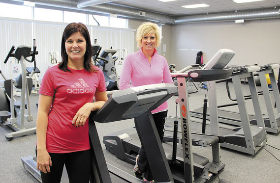 Melissa Roeder and Tonya Roeder give test out some of the equipment at their new venture called On Track Fitness.