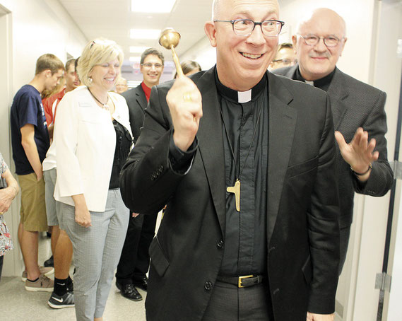 "Archbishop Michael Jackels of the Dubuque Archdiocese sprinkled Holy Water in the new classrooms at Marquette High School last Thursday. The symbolic event signified that the work done on the new school was ""In the name of God"