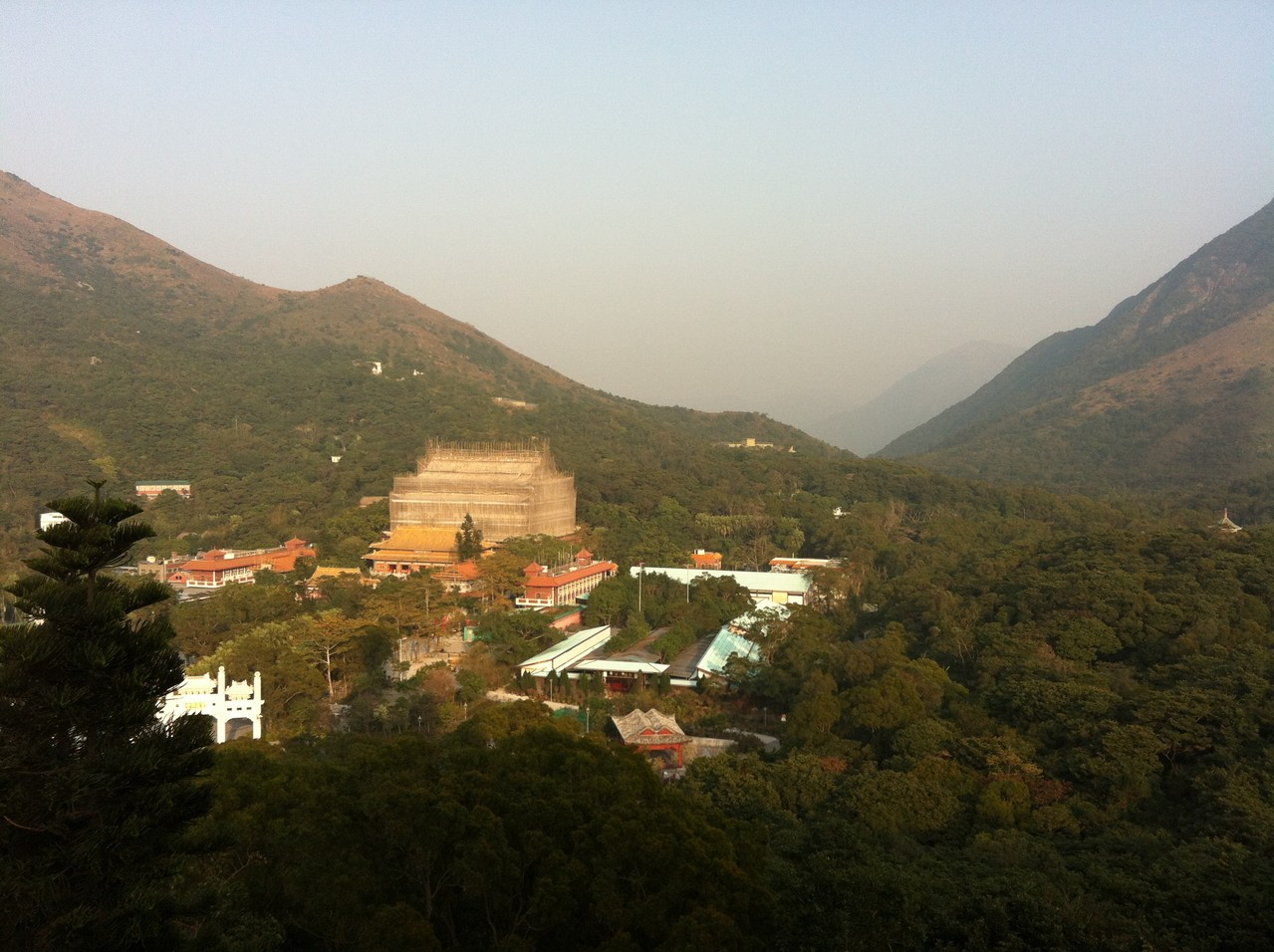 Across the hills is a temple being built/restored. Believe it or not the scaffolding you see is made from bamboo .. — at Ngong Ping 360.