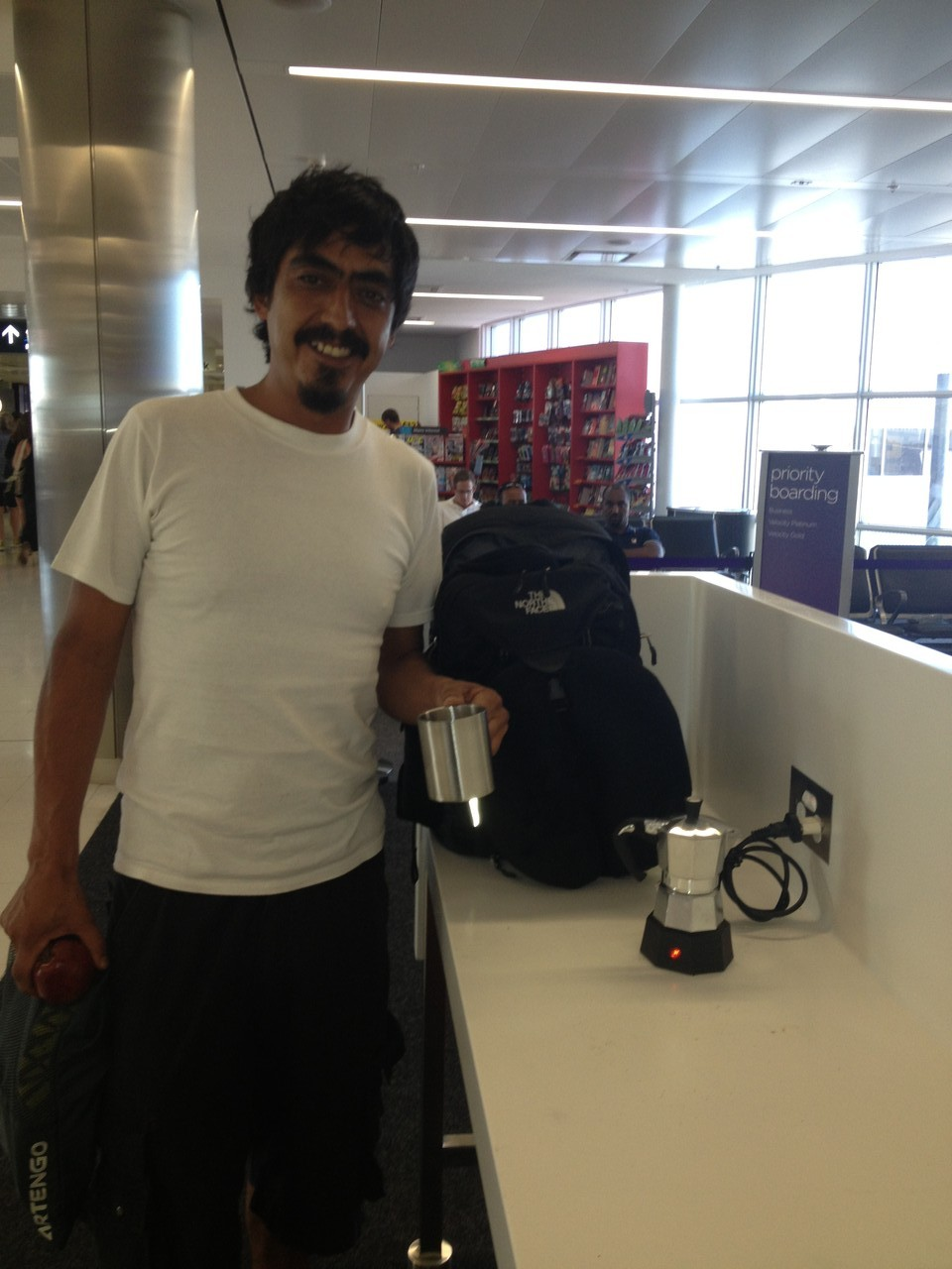 At the airport I was fortunate enough to meet Gabriela's guitar tech Kike with his magic portable coffee machine .... result!! — at Sydney Airport Domestic T2.