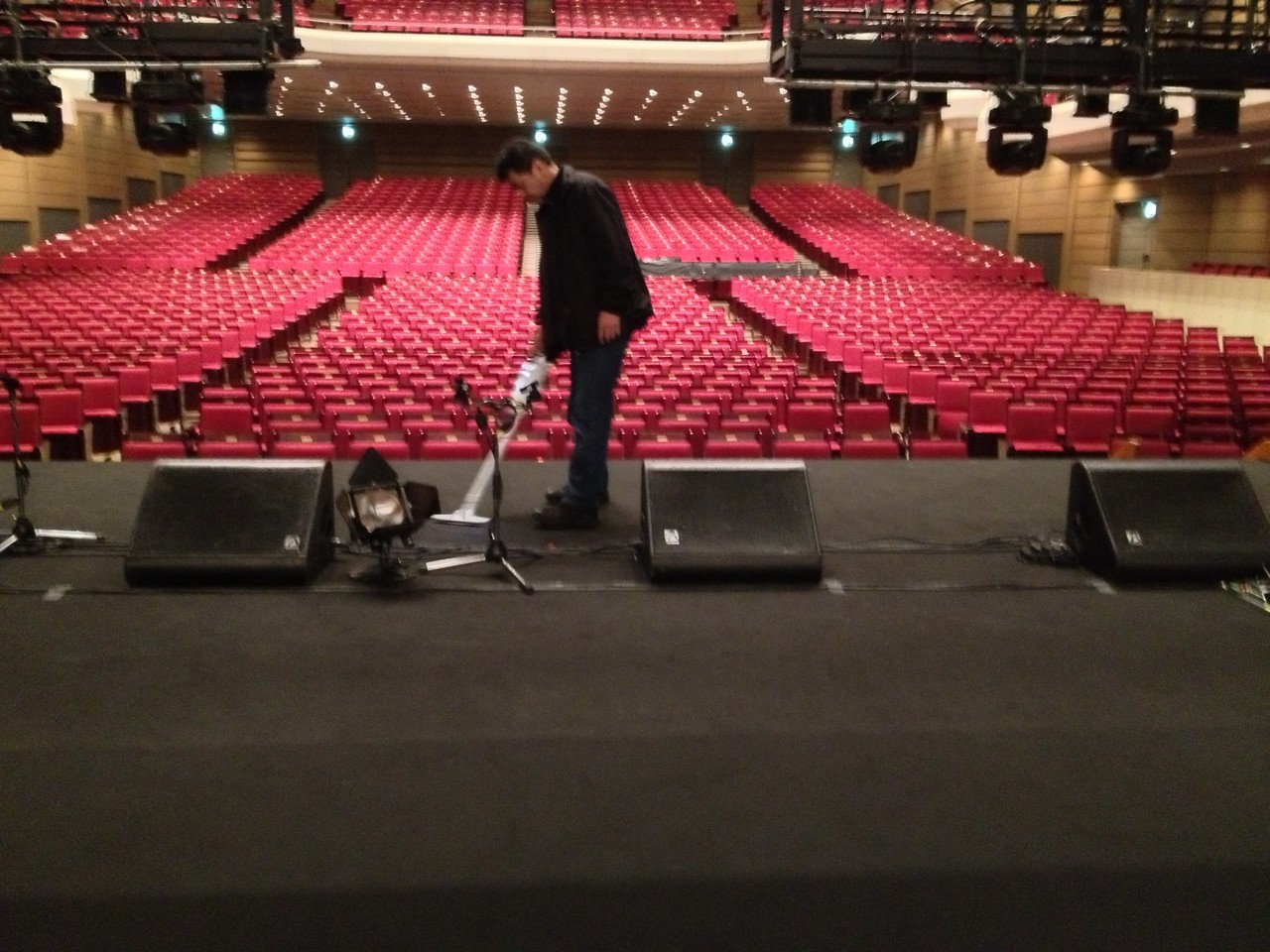 This is what I love about Japan! Guy vacuuming the stage! Everything is pristine here ... — at Orchard Hall Shibuya.