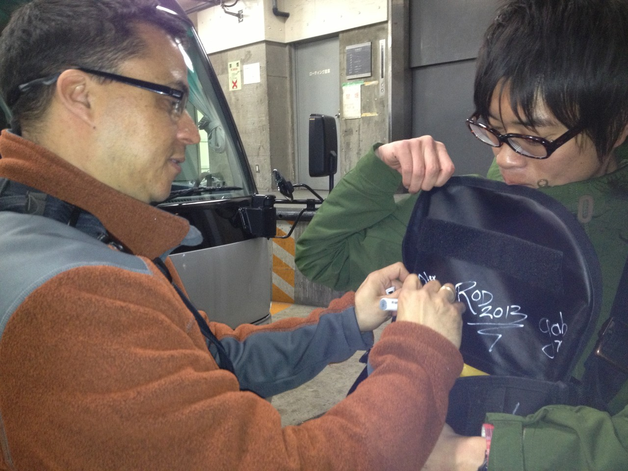 I sign a bag ... a first for me! — at Orchard Hall Shibuya.