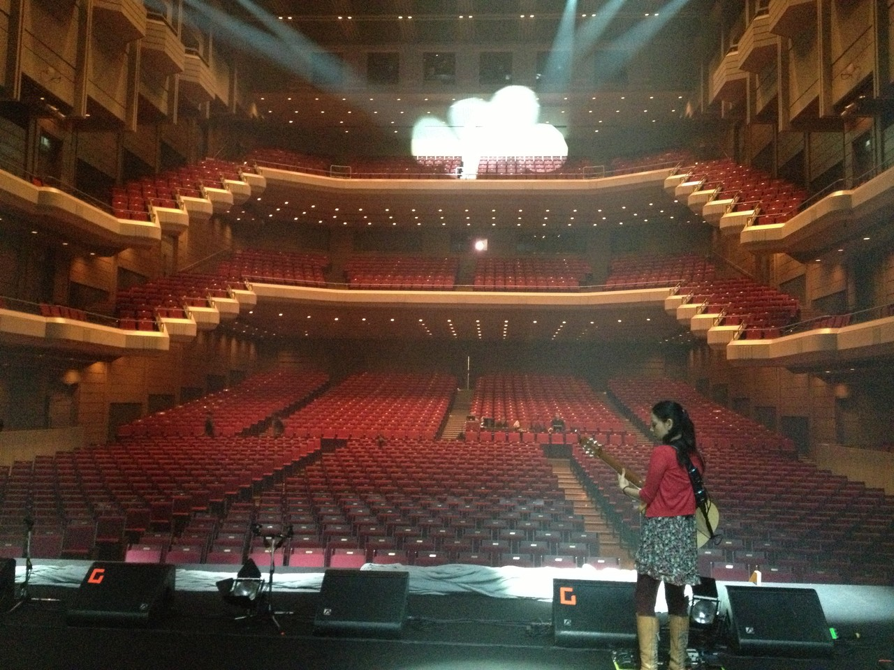 Gabriela checks her guitar .. — at Orchard Hall Shibuya.