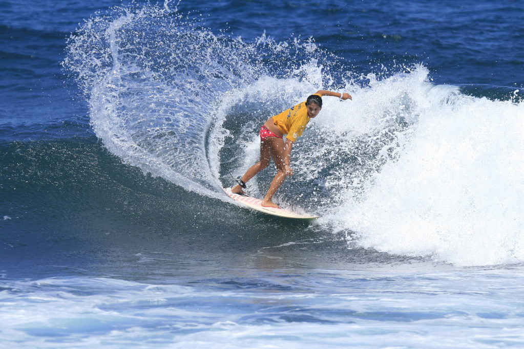 Riding the waves at Middels in Isabela