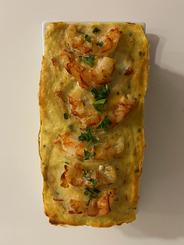 Terrina de merluza y langostinos (opcional curry)