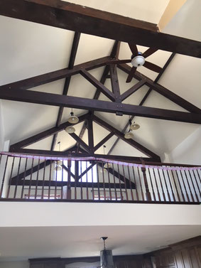 Dark stained pine trusses