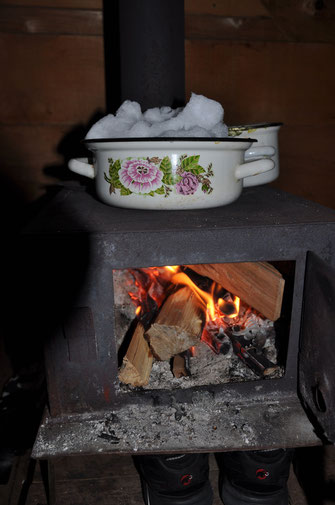 Boiling snow for our pasta dinner in one of the wooden huts in Bakhmaro, 15/02/2016.