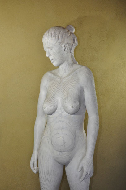 a carved woman nude made of wood from jonathan mollner