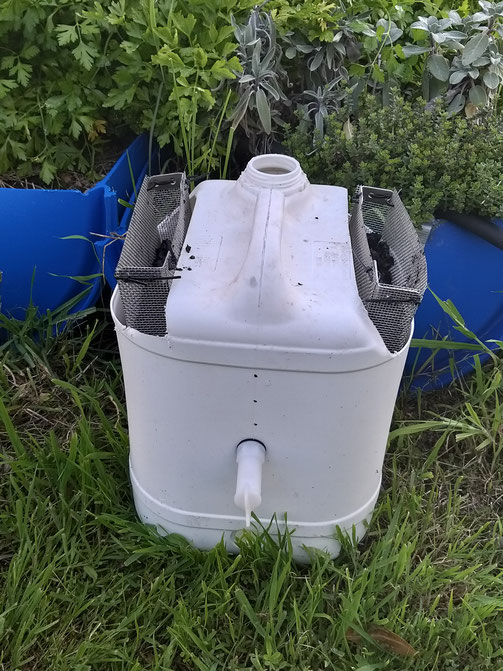The 'Permafilter' standalone CDI unit (with biochar) next to my Permachar Kitchen Garden