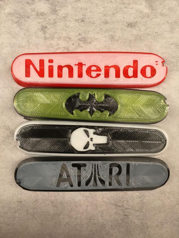Victorinox scales: Batman, Atari, Nintendo, Punisher