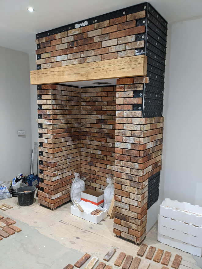 Installation of Birkdale Blend brick slips in conjunction with Brick Slip Tracking Sheets