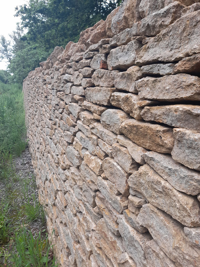 Stone wall - protecting the property from the road noise, and pollution, as well as providing security and privacy
