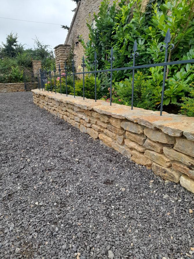 Coping stone, protecting the wall from the weather, as well as helping to finish it off.