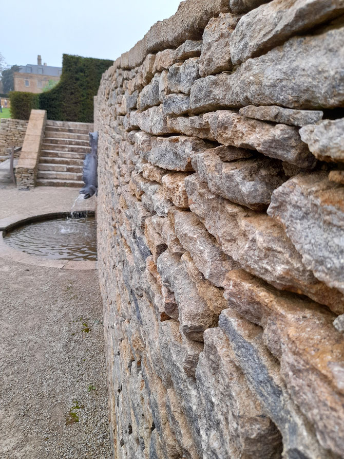 Walling grandeur with matching coping stone, protecting the wall and finishing it off neatly