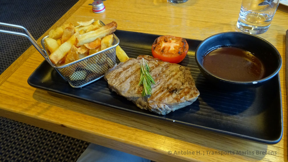 A steack served with its sauce and its crisps at the Explorer Steack House, on board DFDS Seaways' ship King Seaways.