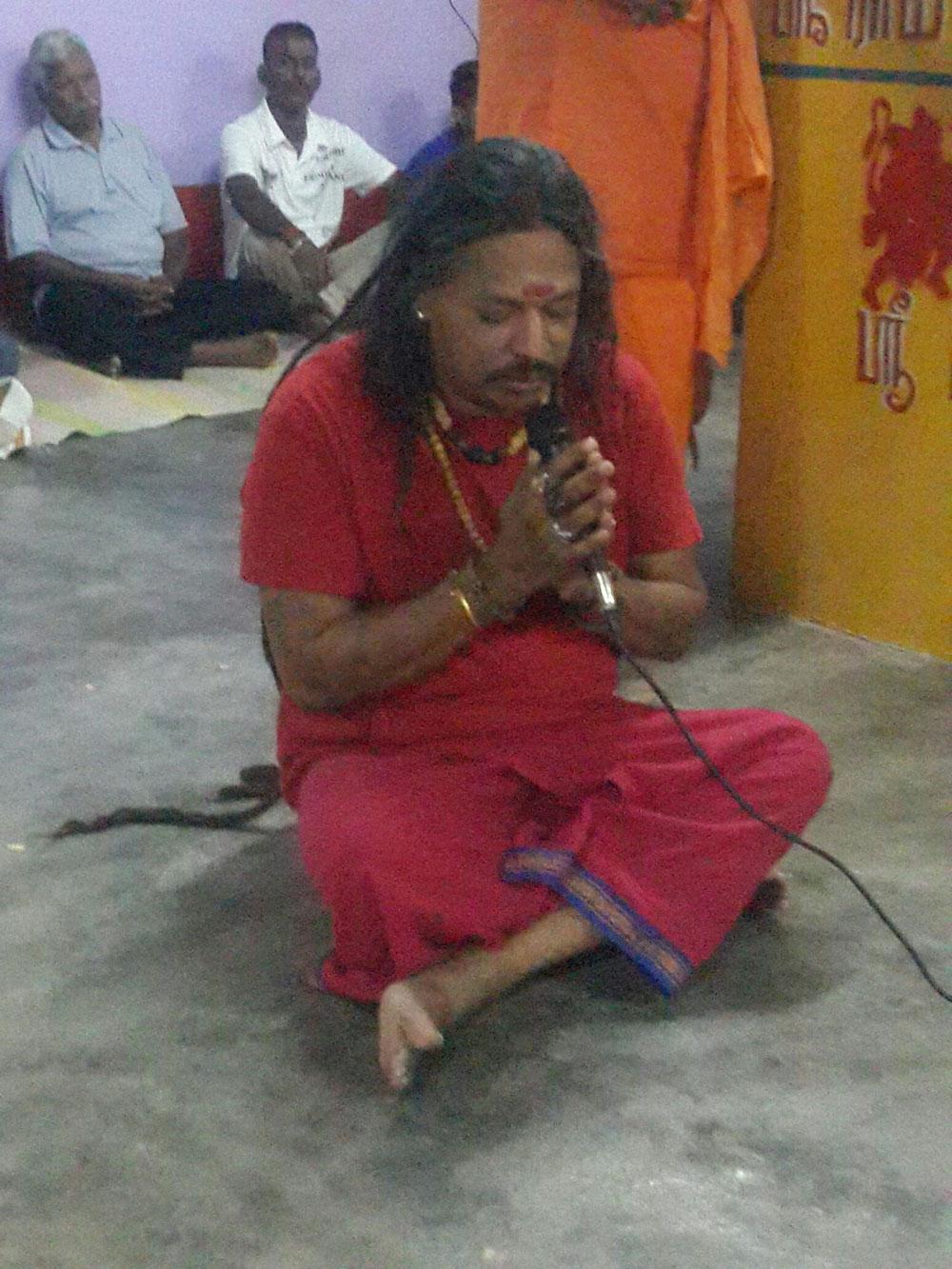Gurudev Aghori Baba holding a speech at a temple in Malaysia
