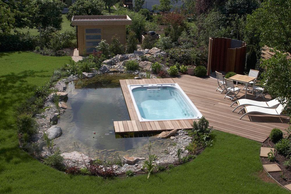 schwimmspa in teichanlage integriert