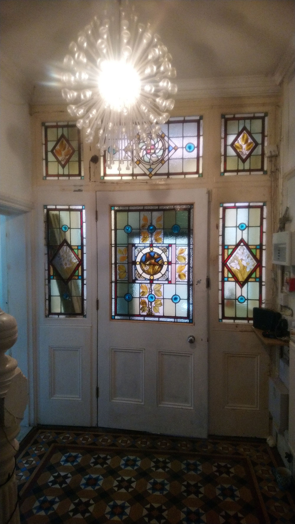 Restoration of frontdoor stained glass panel by  www.rossglassdesigns. coml