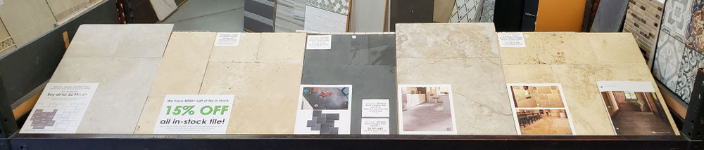 Tile store display with 5 different versailles pattern tile collections made out of porcelain, travertine, and slate.