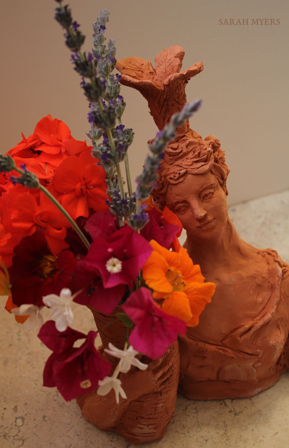 Lady with Plumes and Basket, sculpture by Sarah Myers