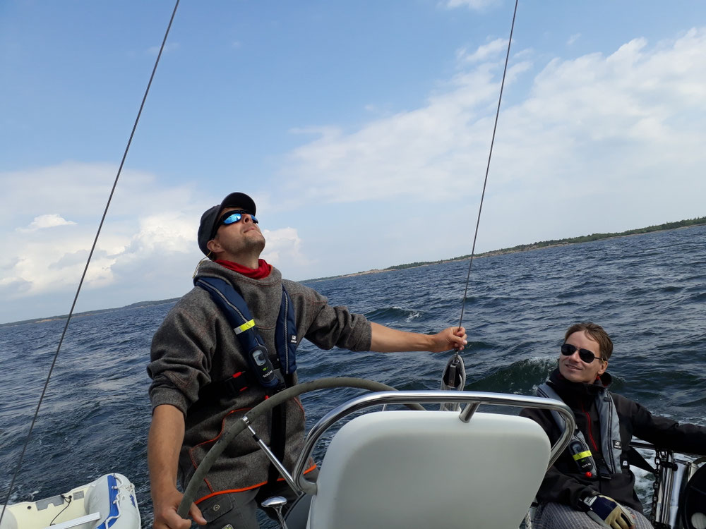 Morten on the helm &Thomas