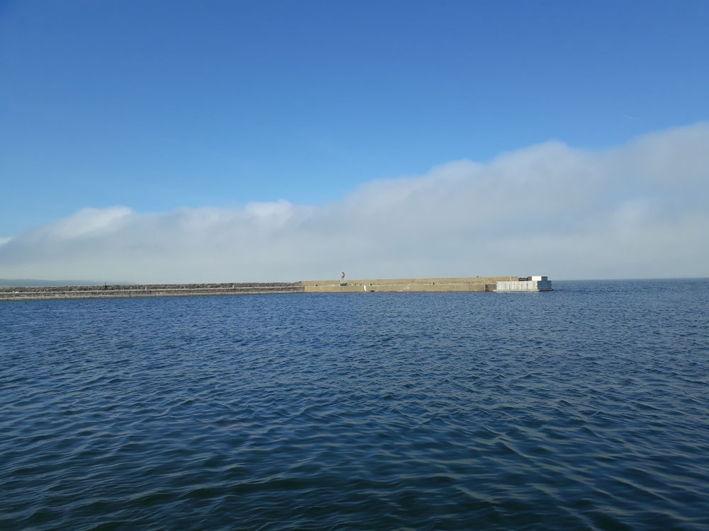 Fog clouds in the distance at Kivik harbor