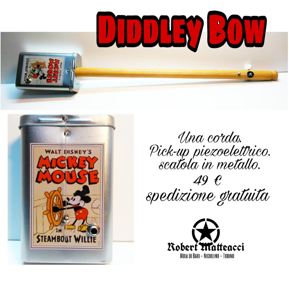 Diddley bow con cassa in metallo, amplificata con pick-up piezoelettrico. Prezzo € 40 compreso spedizione per l'Italia.