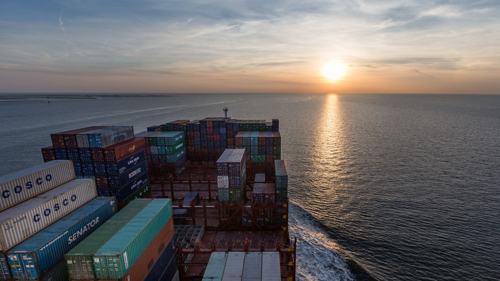 On a container ship in the North Sea towards the sunset