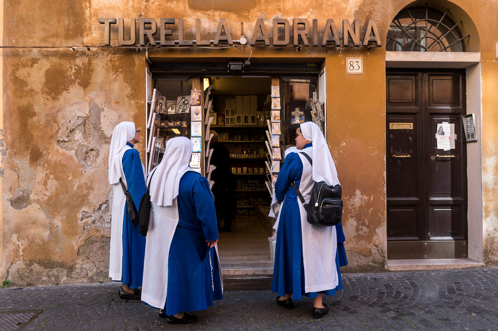 Three nuns at a shop near Vatican in Rome, Italy