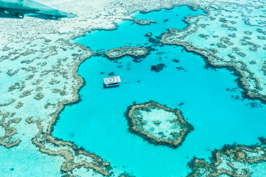 Aerial of Great Barrier Reef with helicopter platform in Australia