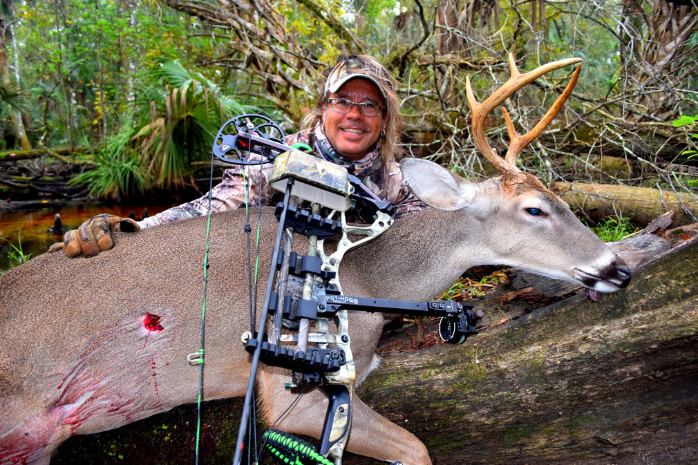 Juan C. Levesque, Bowhunter, with a whitetail buck taken at 20 yards from an elevated stand.