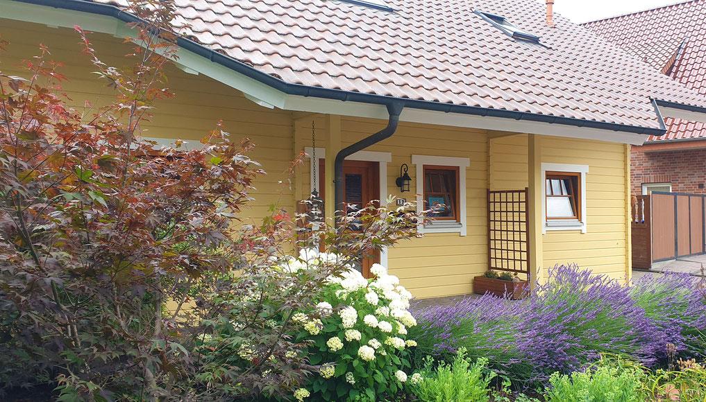 Holzblockhaus Renovierung Aussenfassade