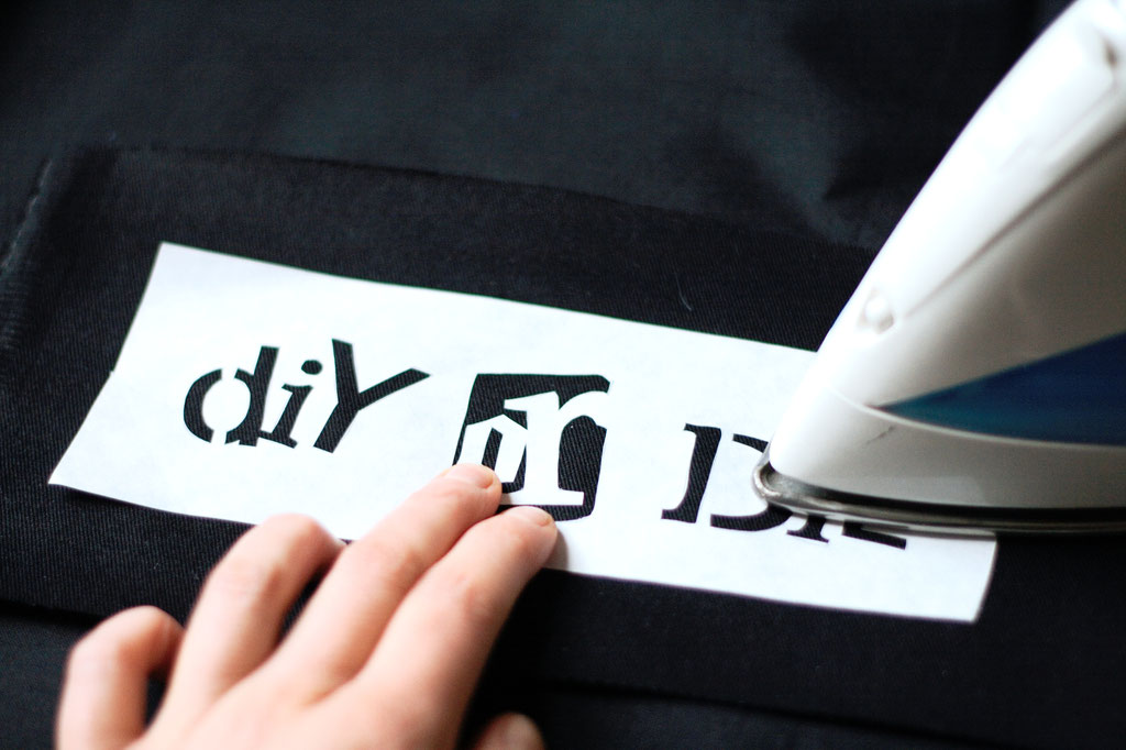 How to stencil on fabric with freezer paper - ironing it on carefully - Zebraspider DIY Anti-Fashion Blog