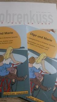 """Auf dem Bild: Das Cover von """"Olga und Marie"""". Zwei Frauen fahren gemeinsam auf einem roten Fahrrad."""