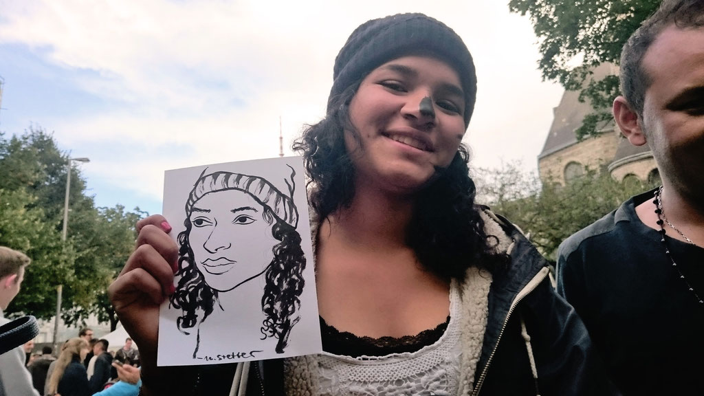 Portraitzeichnen beim Refugees Welcome Fest im Karoviertel, Hamburg. Foto © Felice Vagabonde