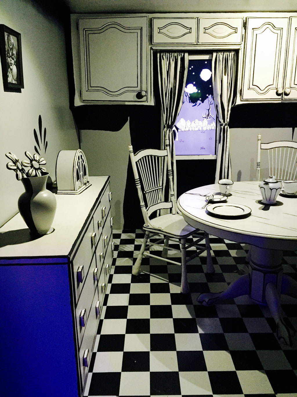 black and white kitchen table meow wolf