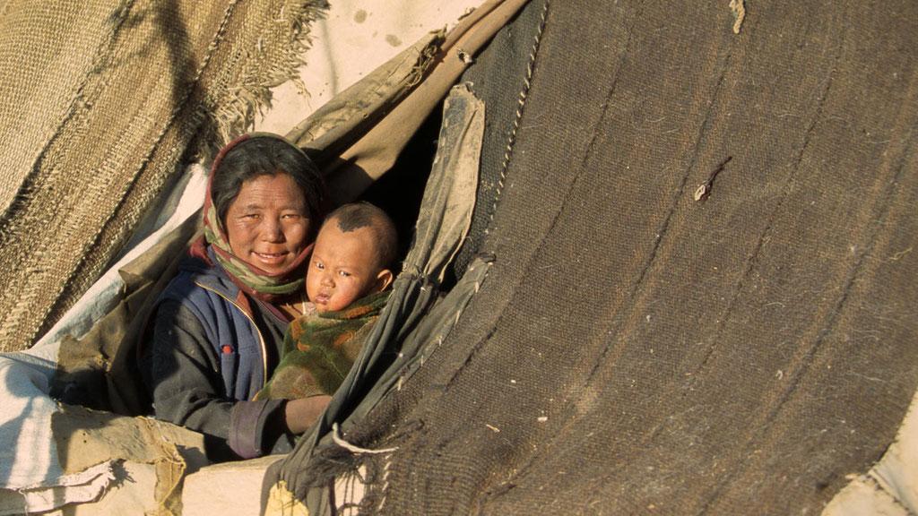 Nomadenfrau mit Kind in Kharnak