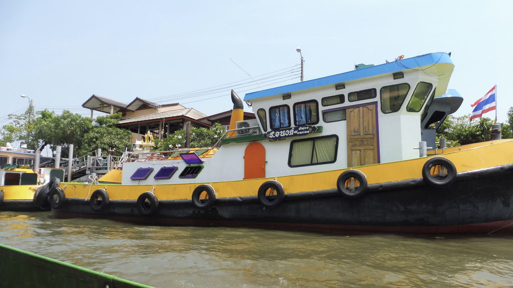 Colourful boats on the Chao Phraya River in Bangkok, Thailand