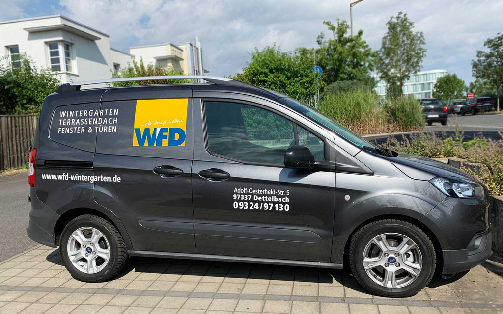 Fahrzeugbeklebung, Fahrzeugbeschriftung der Fa. WFD, Folienbeschriftung