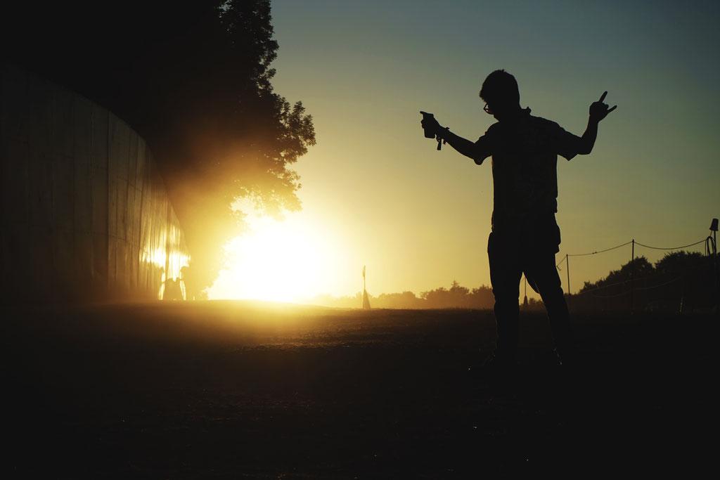 Boomtown Festival,  2016.  Andrea Turco of Tankus the Henge basks in the evening sun.